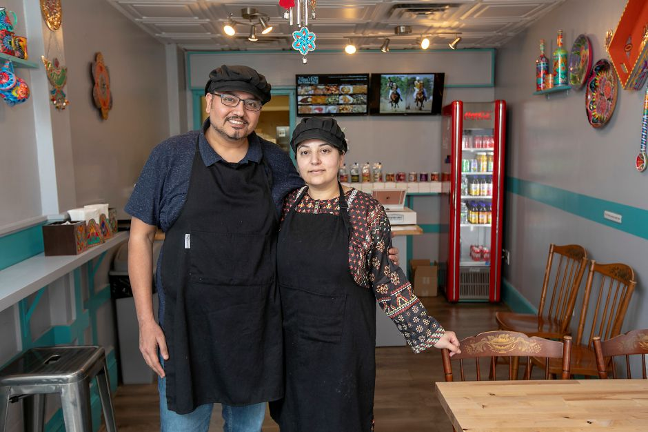 "Atif Anwar and wife Najia ""Nina"" Atif, owners of the new Nina's Desi Kitchen, 26 North Main St. Southington, Fri., Apr. 17, 2020. The restaurant focuses on Pakistani food, mixing a variety of very traditional regional dishes with newer, unique ones. Dave Zajac, Record-Journal"
