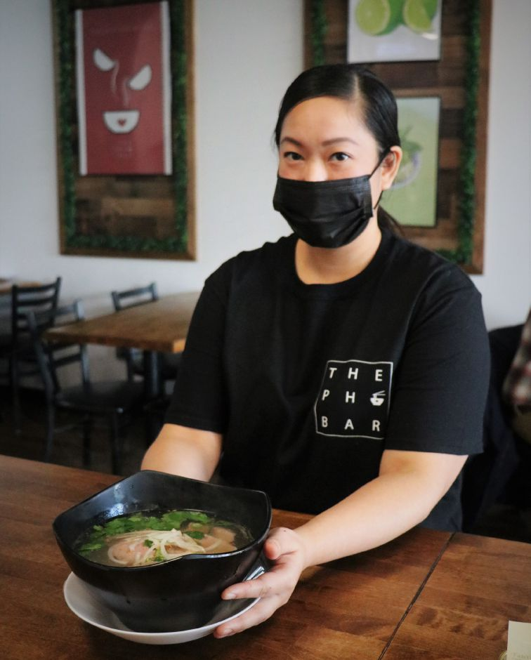 At right: Jessica Rodriguez serves pho soup at the The Pho Bar at  224 Berlin Turnpike in Berlin.
