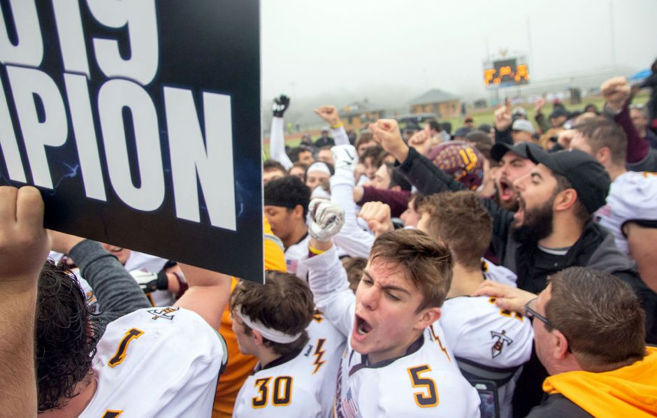 Sheehan celebrates after beating Bloomfield 64-33 at Trumbull High School on Saturday in the CIAC Class S state championship football game. Aaron Flaum, Record-Journal