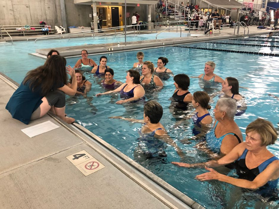 Cammuso instructs her students to huddle close to her as she explains the layout of the Yoga in the Water class at the Cheshire Community Pool. |Kristen Dearborn, Special to Record-Journal