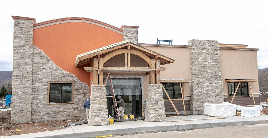Crews work on the main entrance of a LongHorn Steakhouse under construction at 1020 West St. Tues., Jan. 28, 2020. Dave Zajac, Record-Journal