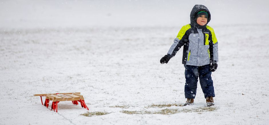 Matthew Gallosa, 3, of Plainville, waits for father Rene after a sled run down a snowy hill at Hubbard Park in Meriden, Tues., Jan. 26, 2021. Snow will continue into tonight bringing two to four inches of accumulation. Dave Zajac, Record-Journal