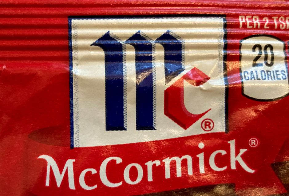 This Tuesday Nov. 24, 2020 photo shows the logo for McCormick & Co. The spice maker is buying the parent of Cholula Hot Sauce from private-equity firm L Catteron for $800 million, expanding its reach in the hot sauce category. That deal included French's mustard and Frank's RedHot brands. The company views the addition of Cholula as a way to appeal to millennials, a group that has a particular liking for the hot sauce. (AP Photo/Donald King)