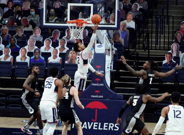 Connecticut guard James Bouknight (2) makes a basket against Providence during the second half of an NCAA college basketball game Tuesday, Feb. 16, 2021, in Storrs, Conn. (David Butler II/Pool Photo via AP)