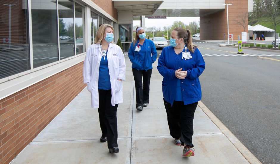 Left to right, Tara Zane, Pavilion B nurse manager, Jenn Kolakoski, Pavilion D nurse manager and Lori Nohilly, director of inpatient nursing and critical care, walk the grounds on a break at MidState Medical Center in Meriden, Fri., May 8, 2020. Dave Zajac, Record-Journal