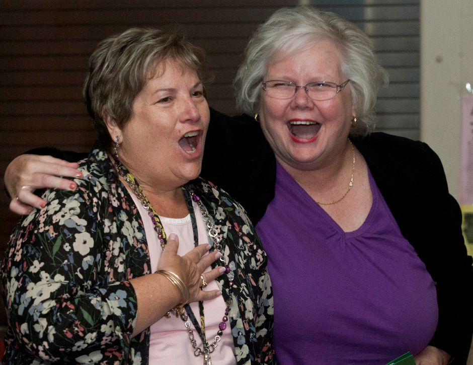 Principal Sally Kamerbeek, left, is shocked by the surprise school assembly farewell party at South End School in Southington on June 6, 2012. Assistant Superintendent Karen Smith, at right, was in on the surprise and kept Kamerbeek in a meeting while the assembly was setup. | File photo.