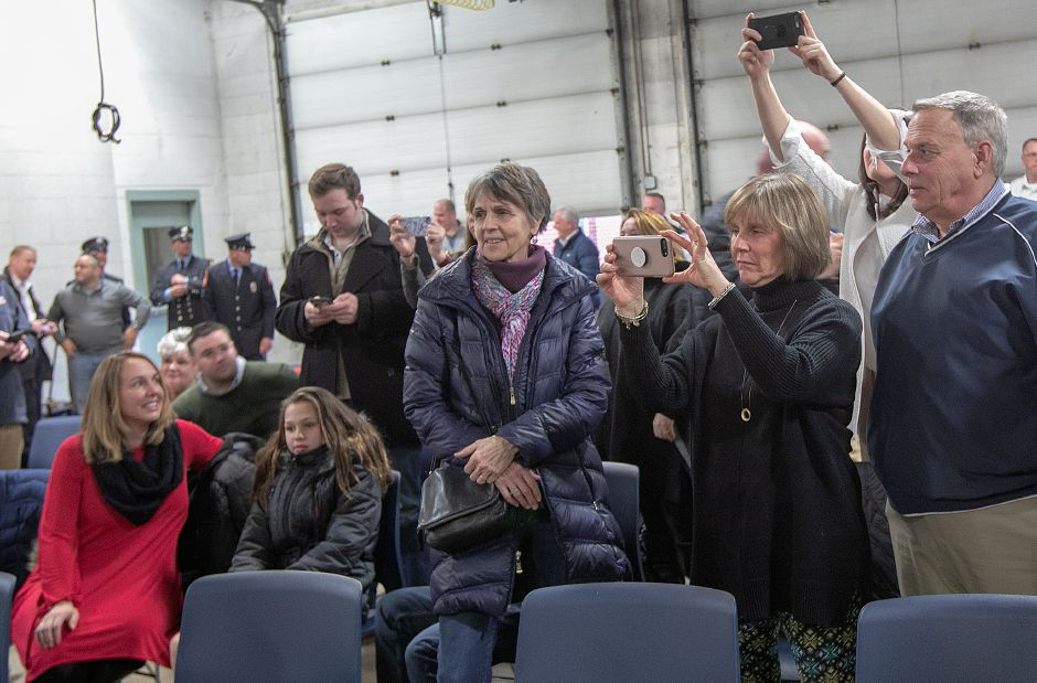 Family and friends of firefighters take photos and video at conclusion of a swearing-in ceremony at Wallingford Fire Headquarters, Wed., Jan. 30, 2019. Dave Zajac, Record-Journal