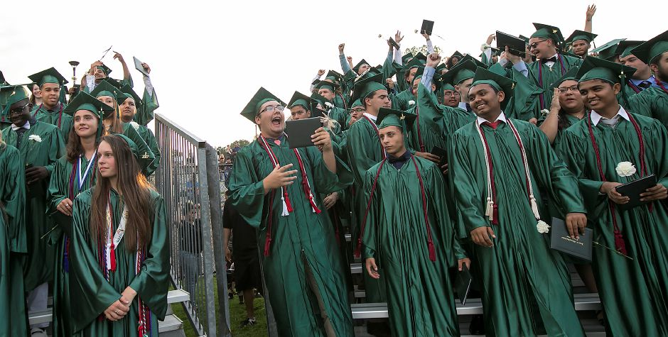 Graduates cheer with their diplomas at conclusion of graduation ceremonies at Maloney High School in Meriden, Tuesday, June 13, 2017. | Dave Zajac, Record-Journal