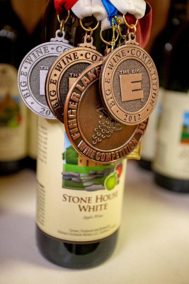 Lots of medals adorn bottles of wine in Bishop