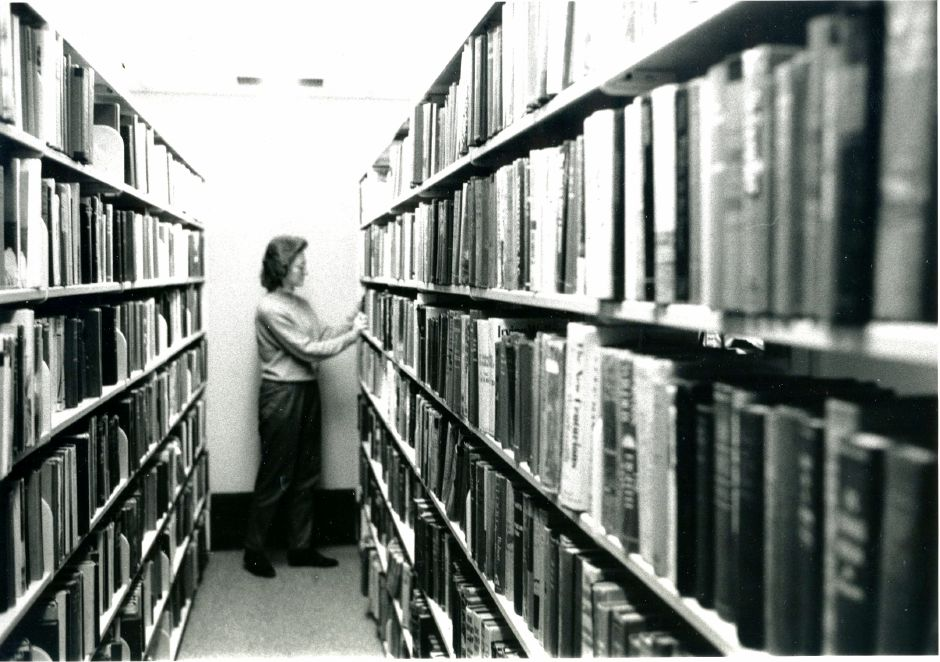Gina Antolini sorts boks at the end of rows of shelves at the Meriden Public Library in February 1986.