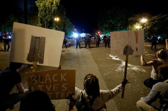Demonstrators pprotest the death of George Floyd, Sunday, May 31, 2020, near the White House in Washington. Floyd died after being restrained by Minneapolis police officers (AP Photo/Alex Brandon)