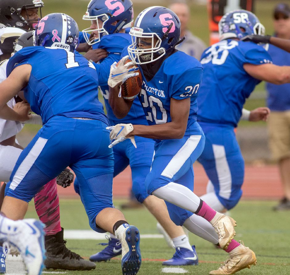 One testament to Southington's depth has been at running back. Marion Bennett (20) has rushed for a combined 151 yards and two touchdowns in the two games team rushing leader Dillon Kohl has missed to injury. The Blue Knights are 7-1 heading into this Friday night's home game against New Britain. | Aaron Flaum, Record-Journal
