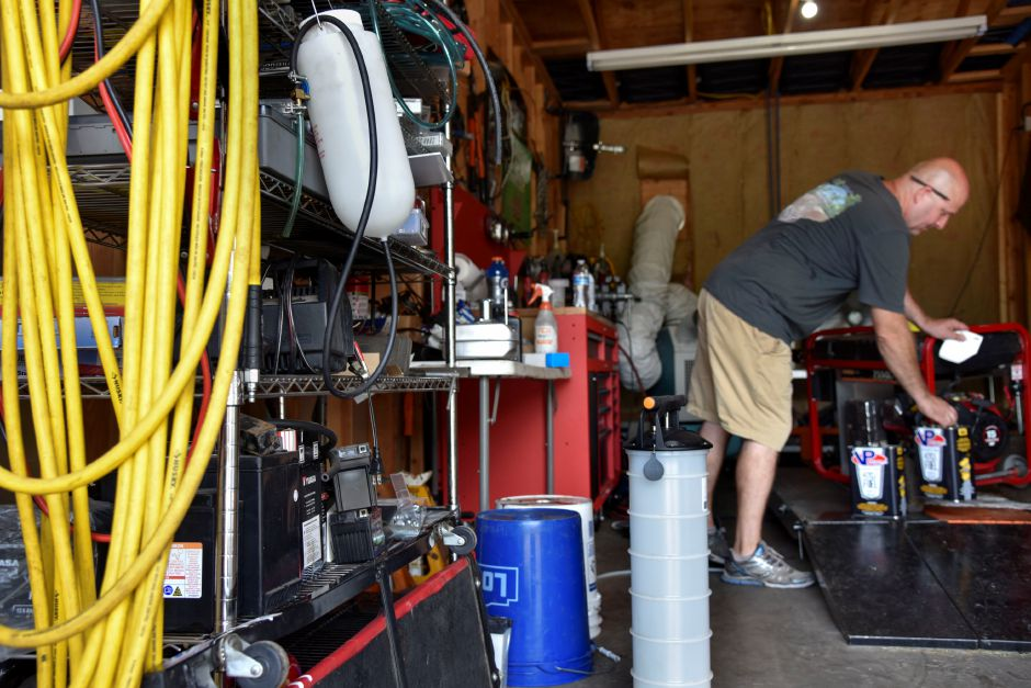 Jaime Sewell, owner of Southington PowerSports, works on a generator at 172 Flanders St. in Southington on Monday, Aug. 10, 2020. After storm Isaias, Sewell has been loaning generators to people in need. | Bailey Wright, Record-Journal