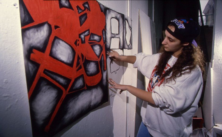RJ file photo - Sheehan High School junior Gina Santucci works on a charcoal drawing showing negative space at the Educational Center for the Arts in New Haven, March 1994.