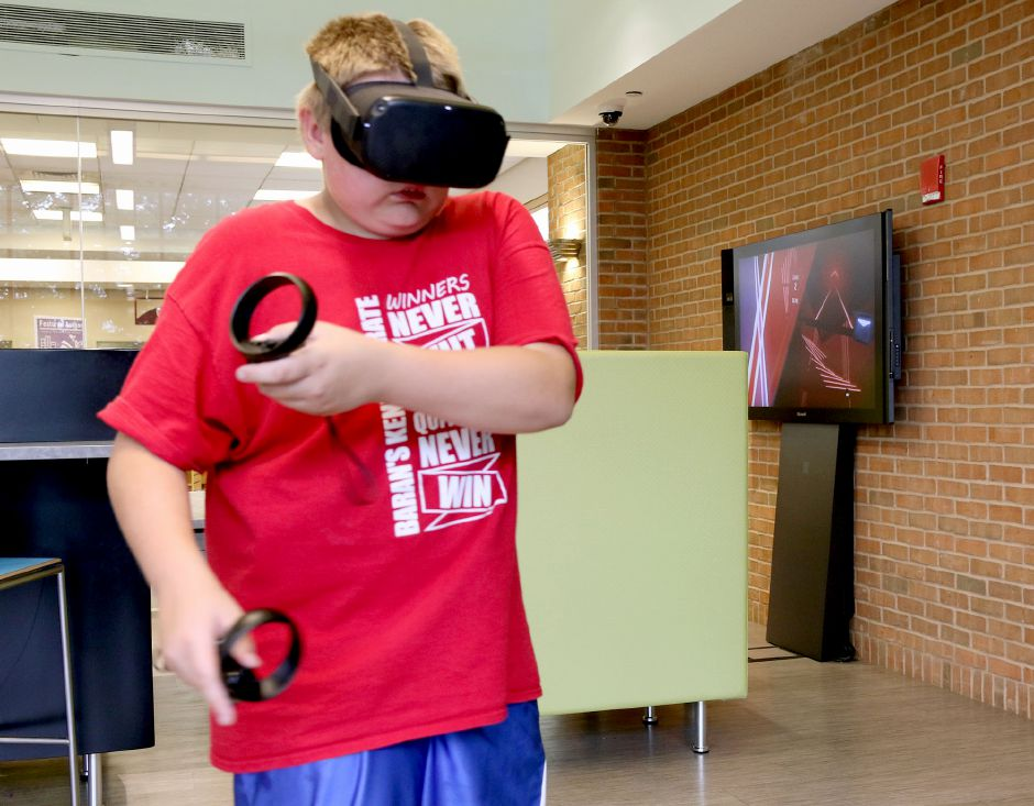 Atreyu Jordan 12 of Meriden, plays Beat Savers during the Virtual Reality Experience for Teens class at the Collaboratory at the Wallingford Public Library on Tuesday August 13, 2019. Aaron Flaum, Record-Journal Staff