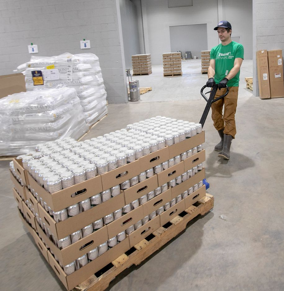 Sam Boersig, canning line operator, moves a pallet of Decadent Mocha Latte brewed at Twelve Percent Beer Project, 341 State St., North Haven, Fri., Jan. 31, 2020. Dave Zajac, Record-Journal