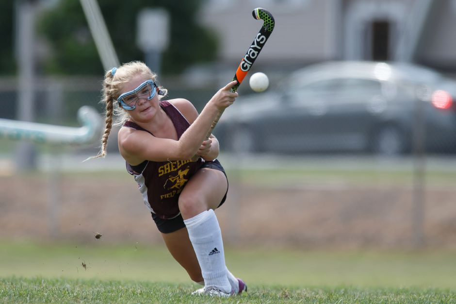 Sheehan sophomore Molly Donegan gets some leverage on a shot Saturday during a field hockey jamboree at Avon High School. Justin Weekes, Special to the Record-Journal