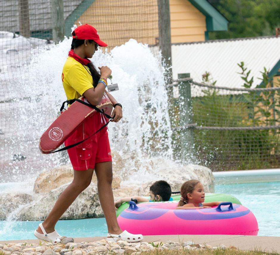 A lifeguard keeps a lookout as swimmers cool off in the Croc-O-Nile.