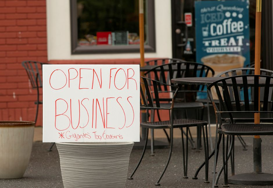 "An ""Open For Business"" sign on the patio of Gigante's Too."