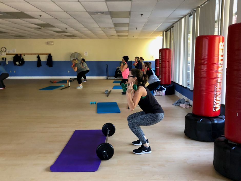 Squats during a Powerology class in Wallingford. |Kristen Dearborn, special to the Record-Journal