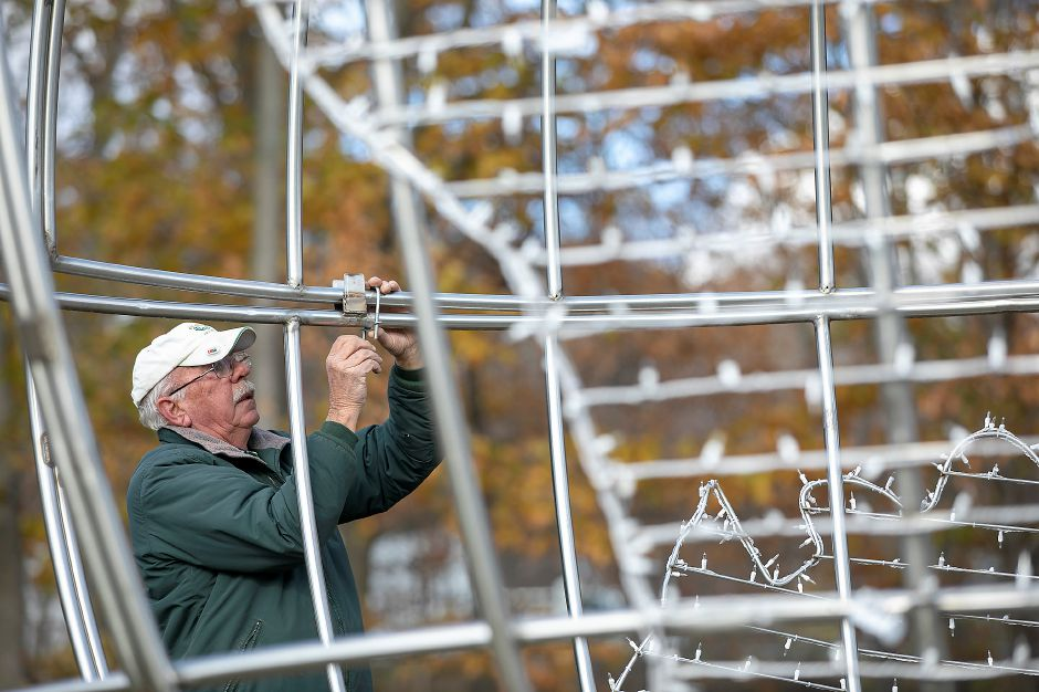 Park worker Rob Zebora clamps together the two halves of the Peace On Earth globe display.