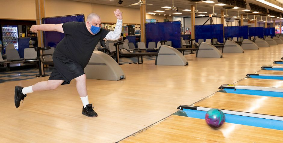 Tommy Mangone, of Brookfield, rolls a left-handed hook during a practice game at Lessard Lanes, 136 New Britain Ave., Plainville, Wed., Jul. 29, 2020. Lessard Lanes has installed shields between alleys as a precaution to the pandemic. Most area alleys have opened back up and Lessard Lanes has made many adjustments to make their bowlers feel safe. Dave Zajac, Record-Journal