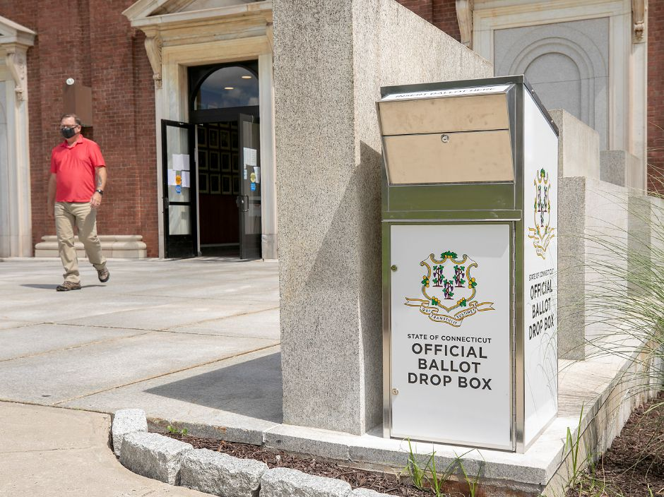 Chris Pudvah, Meriden housing inspector, walks by a new ballot drop box installed on the south side of Meriden City Hall on Tuesday. Photos by Dave Zajac, Record-Journal