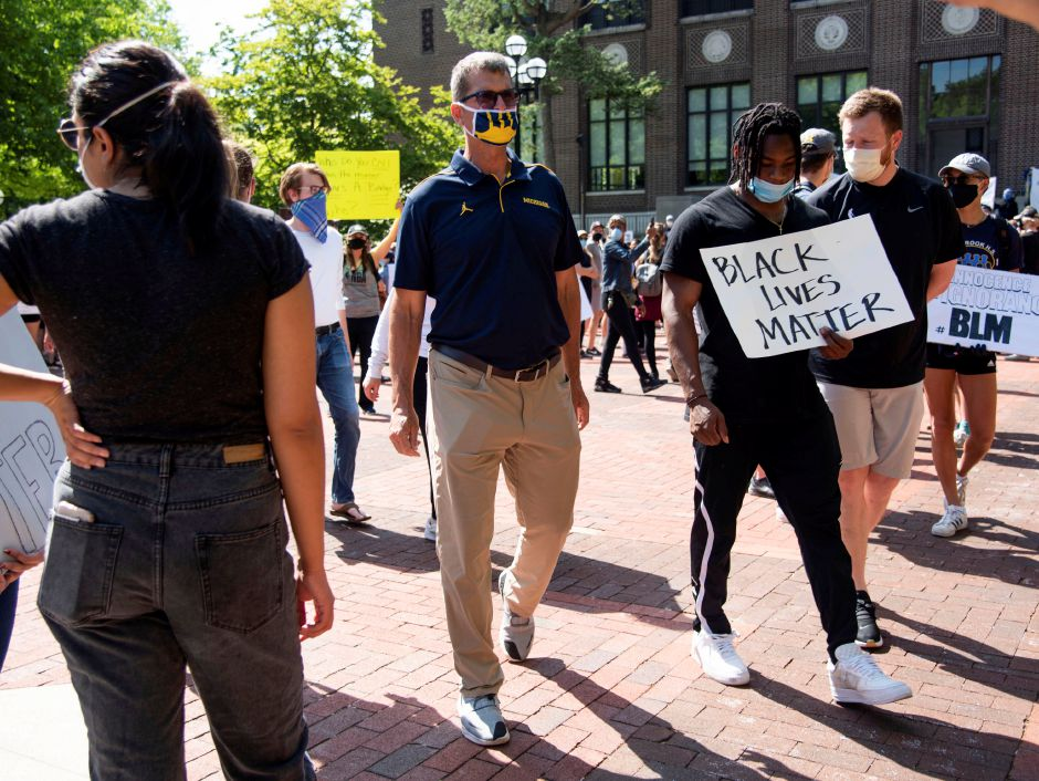 Michigan head football coach Jim Harbaugh attends a Black Lives Matter peaceful protest in Ann Arbor on Tuesday, June 2, 2020. Ann Arbor police chief Michael Cox and other officers walked with demonstrators. Jenna KieserJenna Kieser