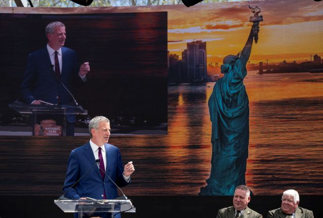 New York Mayor Bill de Blasio speaks during the official dedication ceremony of the Statue of Liberty Museum on Liberty Island Thursday, May 16, 2019, in New York. De Blasio announced Thursday that he will seek the Democratic nomination for president, adding his name to an already long list of candidates itching for a chance to take on Donald Trump. (AP Photo/Craig Ruttle)