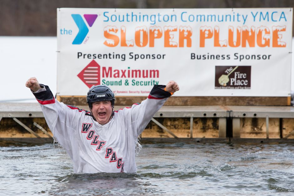 Dr. Al Natelli celebrates his 13th time jumping Saturday during the 13th Annual YMCA Camp Sloper Plunge at Camp Sloper in Southington. The event helps to raise money for kids to attend camp. January 20, 2018 | Justin Weekes / Special to the Record-Journal