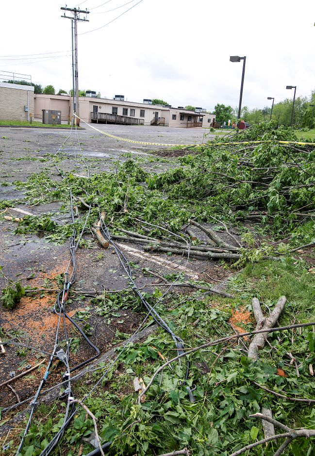 Fallen limbs and downed wires at Cook Hill Elementary School in Wallingford, Thursday, May 17, 2018. Dave Zajac, Record-Journal