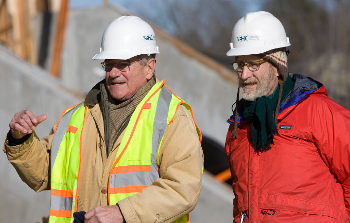 Michael Kerr, chief executive officer, left, and Christian Conover, chief marketing officer, of New England Hydropower Company LLC, talk about the installation of a 20-ton, 35-foot-long metal screw at Hanover Dam in South Meriden, Tuesday, December 20, 2016. The Archimedes screw, named for the ancient Greek scientist credited with its invention, is the first of its kind installed in the U.S.  | Dave Zajac, Record-Journal