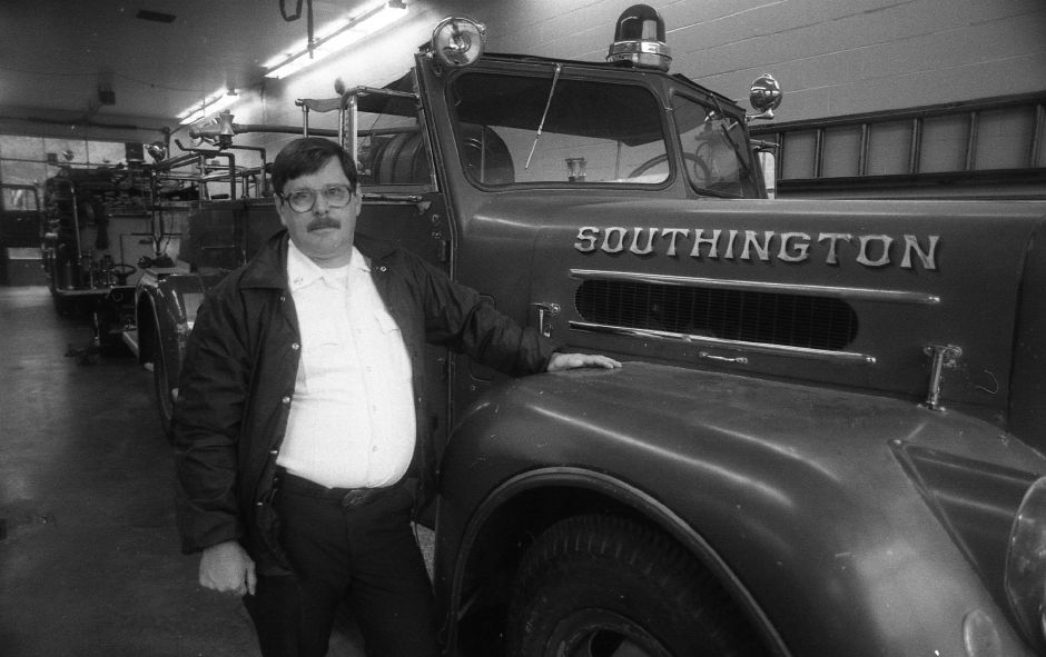 RJ file photo - Southington Assistant Fire Chief Richard McDonough poses in front of a 1952 Maxim truck.