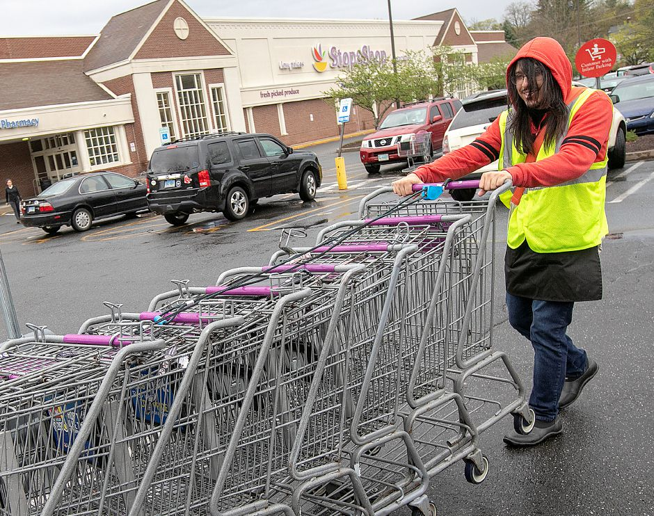 Employee Martin Kearney, of Meriden, collects shopping carts.