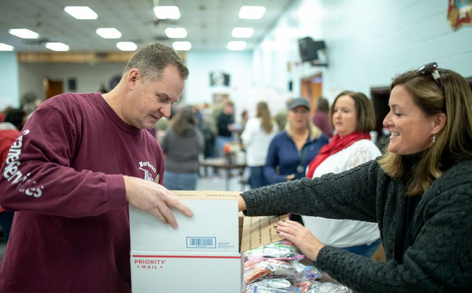Mike Buchholz receives items to be sent to soldiers overseas at the New Britain VFW for the Hero Boxes care package packing day on Nov. 9, 2019. The Berlin-based non-profit sends hundreds of care packages to soldiers serving in war zones each year. | Devin Leith-Yessian/Berlin Citizen