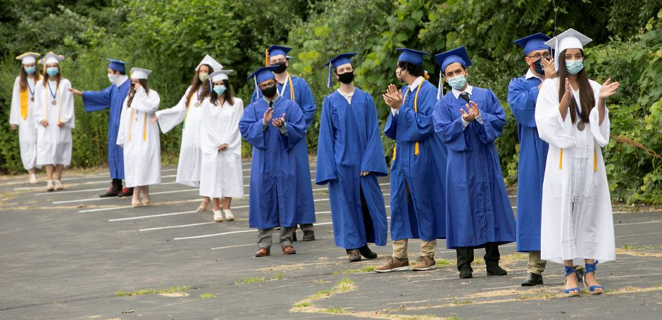 Lyman Hall High School graduates line up to receive their diplomas during graduation ceremonies at the Toyota Oakdale Theatre in Wallingford, Tues., Jul. 7, 2020. Dave Zajac, Record-Journal