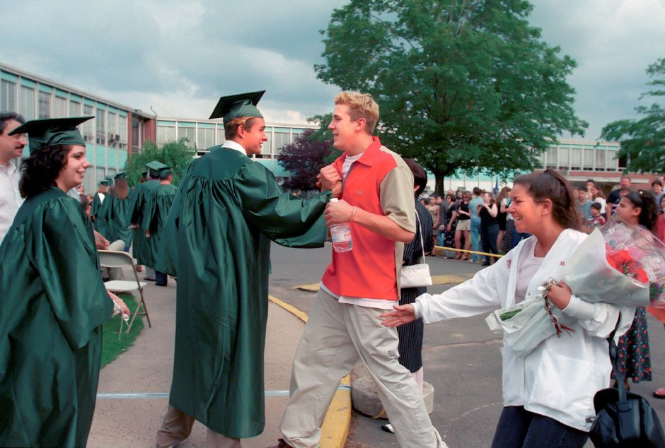 RJ file photo - Dave Vega, left center, shakes the hand of best friend John Walker during the procesion to the stage at Maloney High School June 17, 1998.