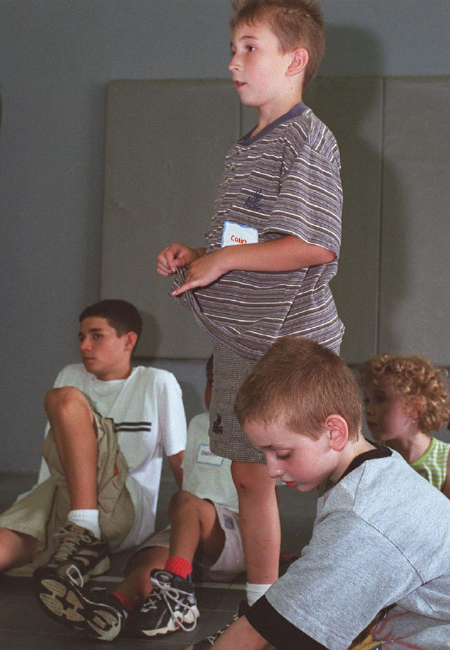 Colin Polak of Meriden recounts a personal anecdote on the topic of kidnapping to his peers during a session at Tiowa camp at Healthworks where kids discuss safety and health issues July 10, 2000.