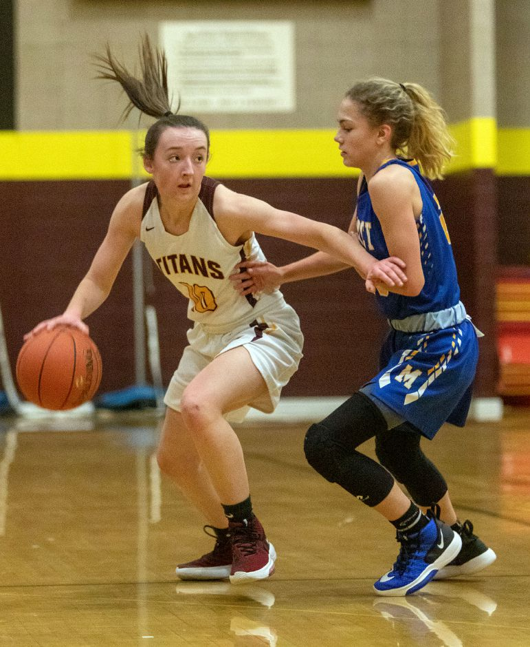 Sheehan's Caroline Dighello works on getting past Mercy's Sophie Hedge during the first half of Friday's game at Sheehan High School. Aaron Flaum, Record-Journal