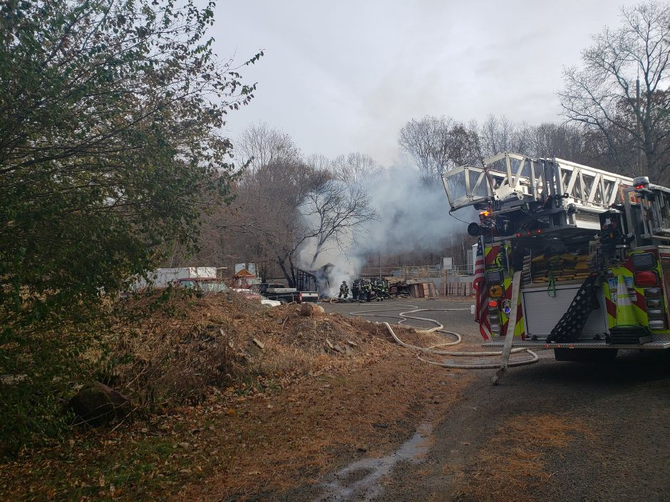 Crews fight fire in the area of 1150 Old Colony Rd. |Lauren Sellew, Record-Journal