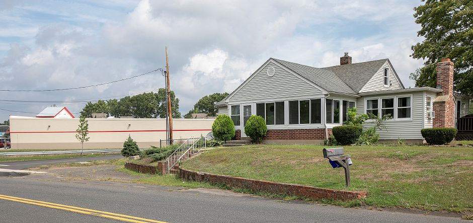 A house at 8 Beaumont Rd., right, next to Tractor Supply, left, in Wallingford, Wed., Aug. 21, 2019. Dave Zajac, Record-Journal