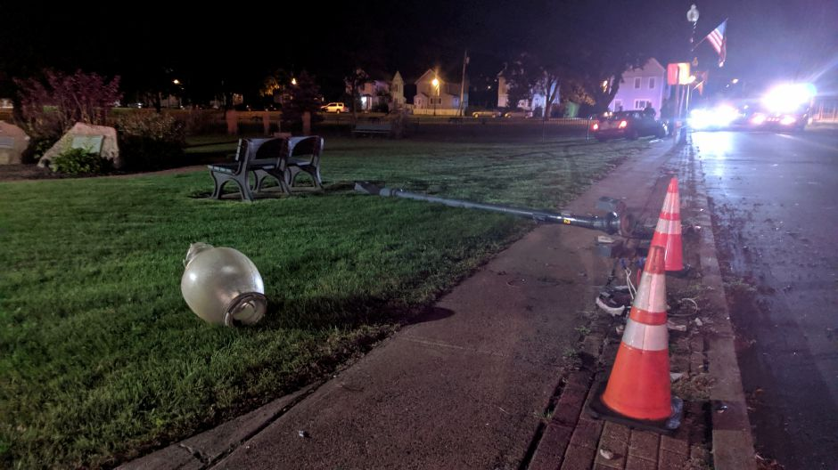 A 29-year-old Meriden woman faces drunk driving charges after crashing her vehicle into a lamp post on Quinnipiac Street Tuesday night. The vehicle is seen having come to a stop along the grass at Wallace Park — more than 100 feet away from the lamp post./Michael Gagne, Record-Journal