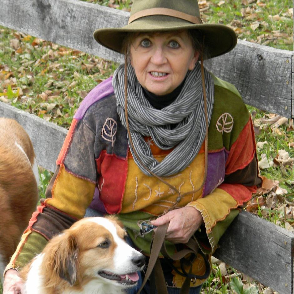 Durham resident, and author, Andrea Steele is pictured with her dogs. Steele