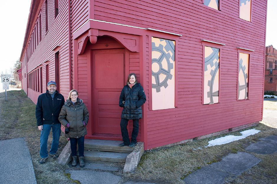 David Arai, project architect, Karin Arai, board member and organization treasurer, and Ilona Somogyi, co-founder and president, pose recently outside of Building 1 at Ball & Socket Arts on West Main Street in Cheshire. Al Valerio, Cheshire Herald