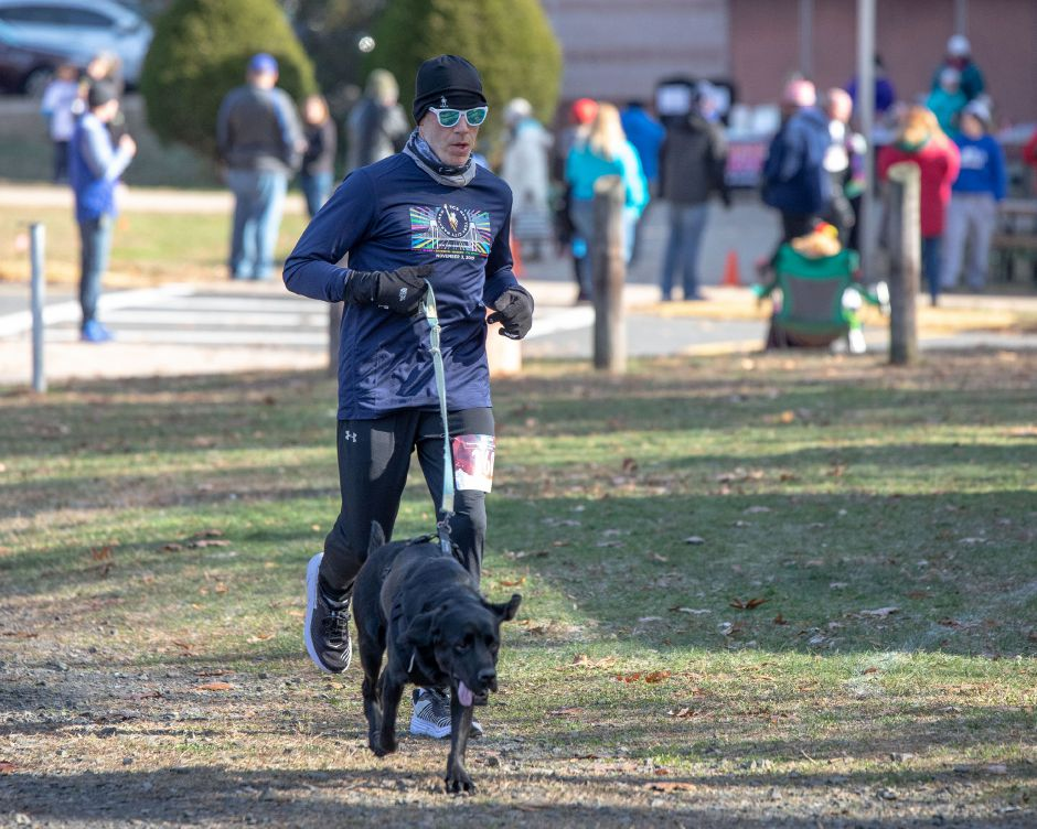 "A runner nears the finish line in the ""Thanks for Giving"" race on Oct. 9, 2019. Looping around the Middle School of Plainville, the run raised around $7,000 — over half the money needed to fund the spring sports program at the school. 