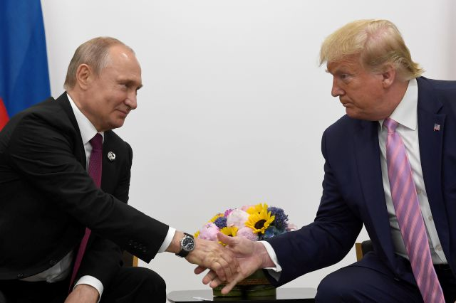 FILE - In this June 28, 2019, file photo President Donald Trump, right, shakes hands with Russian President Vladimir Putin, left, during a bilateral meeting on the sidelines of the G-20 summit in Osaka, Japan. For the past three years, the administration has careered between President Donald Trump