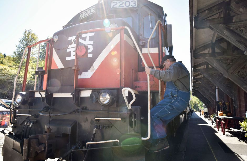 Engineer Howard Pincus climbs down from the locomotive