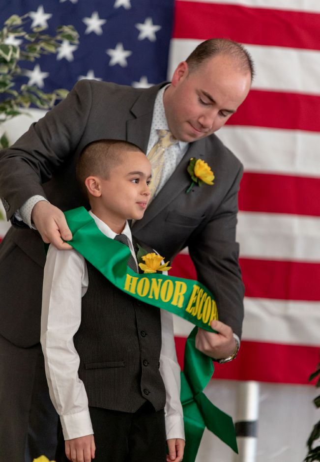 Mayor Mark Scarpati names Kayden Rodriguez, 8, of Israel Putnam Elementary School, to be the escort for Little Miss Daffodil nominee Scarlett Gibbs in the Meriden Daffodil Festival Parade on April 27, 2019. A crowning ceremony was held on April 24, in Hubbard Park where the nominees were selected by raffle. | Devin Leith-Yessian/Record-Journal