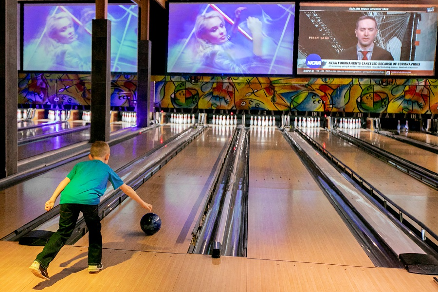 Left: Nathan Huffman, 7, of Columbus, Indiana, hopes for a strike while bowling Friday at Crystal Bees in Southington. Large events, such as upcoming concerts, have been canceled at the business. Right: The Aqua Turf Club in Southington. Photos by Dave Zajac, Record-Journal