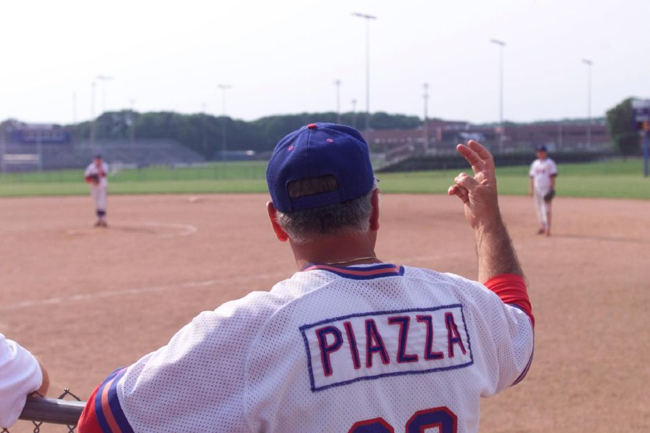 Southington softball coach Joe Piazza signals to players during the Norwalk game, June 1999.